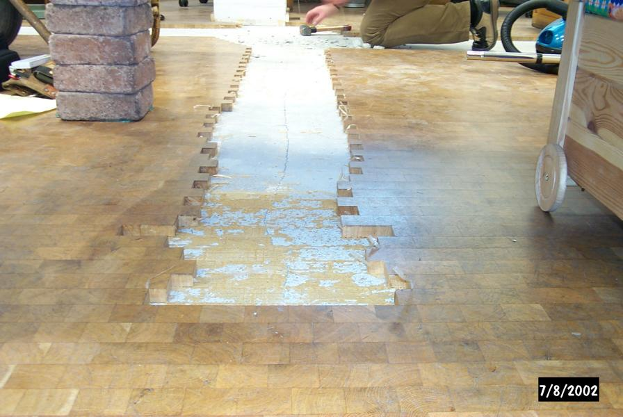 Expert's opinion on parquet damage in a goldsmith's workshop